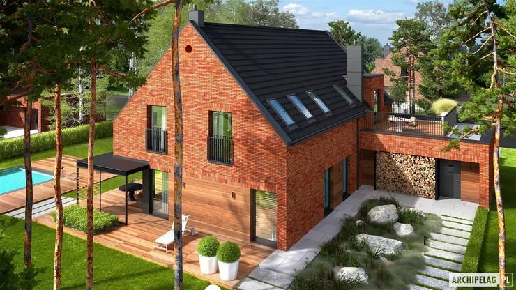 Projekt domu Teodor G2 - luksus przestrzeni i ponadczasowa uroda klinkieru w roli głównej  : styl , w kategorii Dom jednorodzinny zaprojektowany przez Pracownia Projektowa ARCHIPELAG