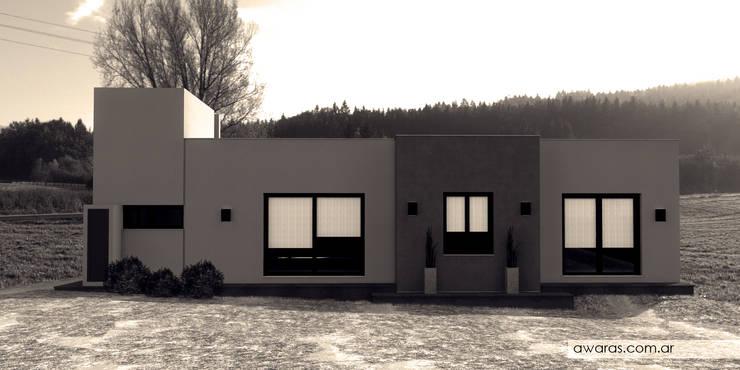CASA CG | fachada sur: Casas unifamiliares de estilo  por áwaras arquitectos,