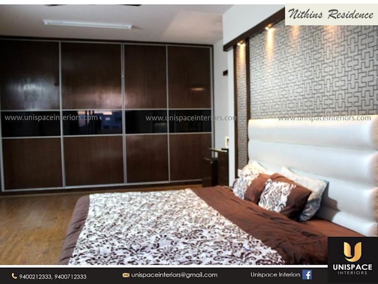 RESIDENCE VILLA APARTMENT INTERIORS -CONTEMPORARY INTERIORS- BEDROOM:   by UNISPACE INTERIOR