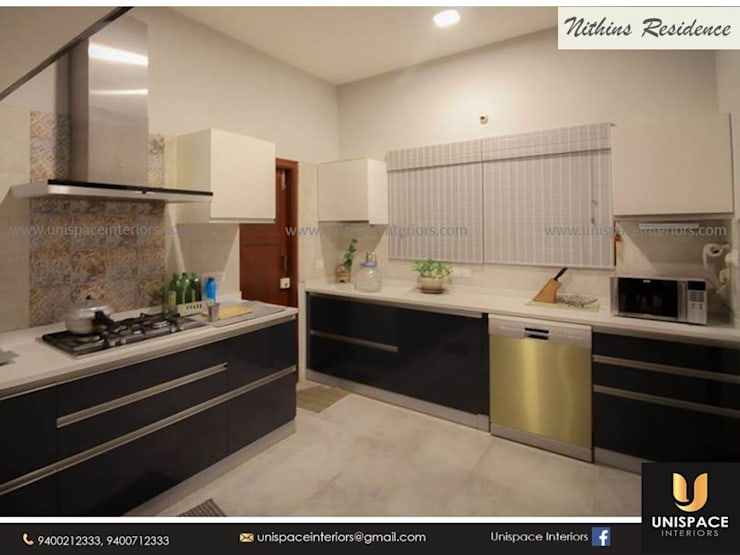 RESIDENCE VILLA APARTMENT INTERIORS -CONTEMPORARY INTERIORS- KITCHEN:   by UNISPACE INTERIOR