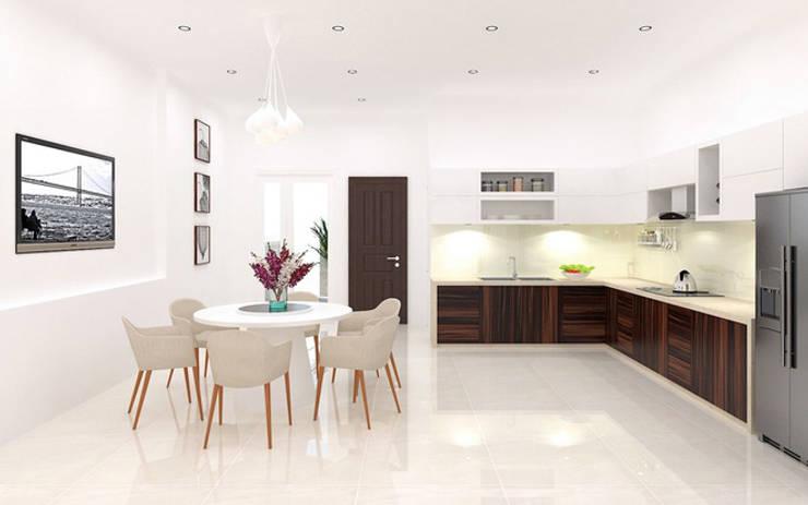 Thiết kế nội thất khu bếp ăn cân đối và hợp lý phù hợp của nhà phố hiện đại.:  Phòng ăn by Công ty TNHH Thiết Kế Xây Dựng Song Phát