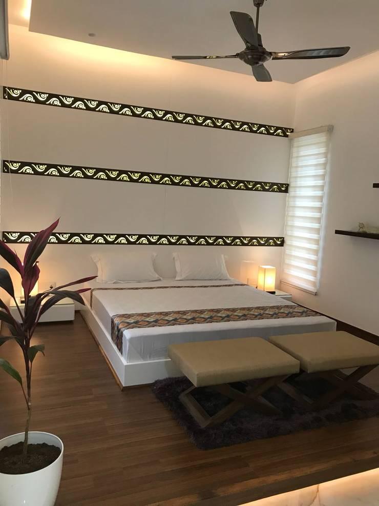 Guest Bed Room: modern Bedroom by HM DESIGNZ