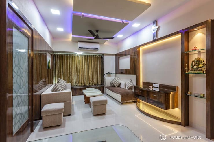 2BHK residence:  Living room by solids and voids
