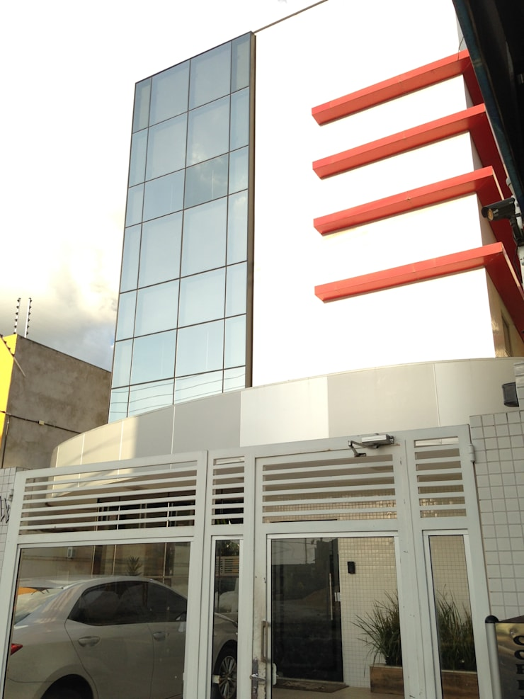 Fachada frontal: Edifícios comerciais  por Marcos Assmar Arquitetura | Paisagismo
