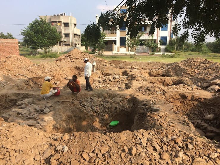Excavation for isolated footings:  Multi-Family house by Cfolios Design And Construction Solutions Pvt Ltd