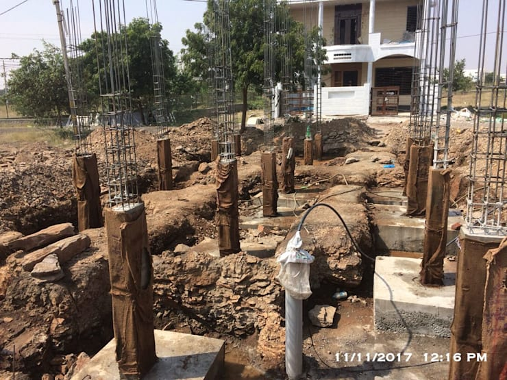 Casting of RCC Stub columns:  Multi-Family house by Cfolios Design And Construction Solutions Pvt Ltd