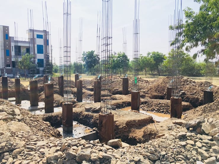 Casting of Stub columns:  Multi-Family house by Cfolios Design And Construction Solutions Pvt Ltd