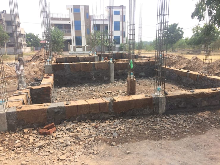 Casting of Plinth beams:  Multi-Family house by Cfolios Design And Construction Solutions Pvt Ltd