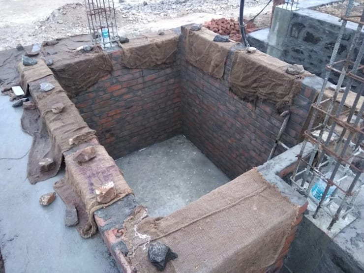 Construction of sump Tank:  Multi-Family house by Cfolios Design And Construction Solutions Pvt Ltd