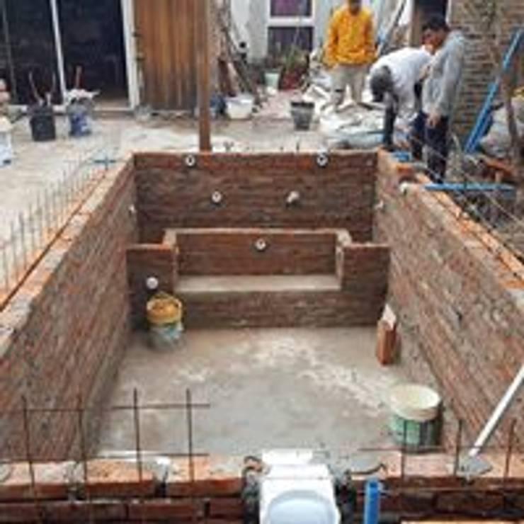 Proyecto de pileta con cascada y jacuzzi en buenos aires for Diseno y construccion de piscinas de hormigon