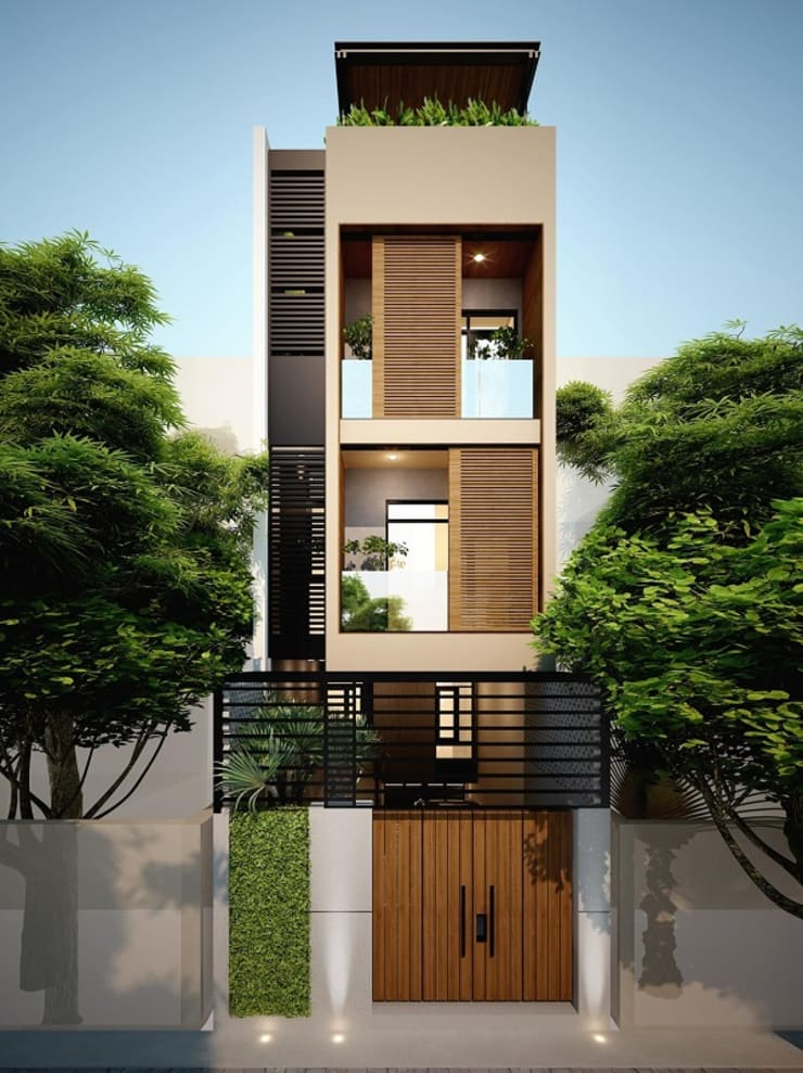 Cây xanh được bố trí gần như ở tất cả các không gian với các loại cây xanh dễ trồng.:  Nhà gia đình by Công ty TNHH Thiết Kế Xây Dựng Song Phát