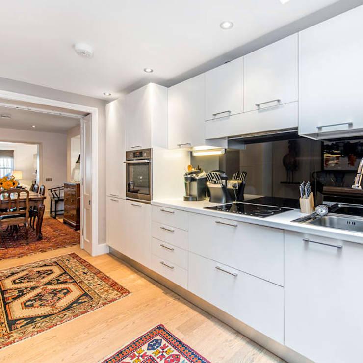My First House: modern Kitchen by John Doe Architects