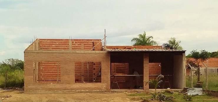 Construcción : Casas de estilo  por M2 Arquitectura,