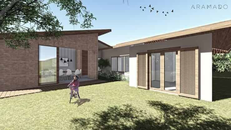 Casa da Fotógrafa -  Fachada posterior: Jardins de fachadas de casas  por ARAMADO arquitetura+interiores