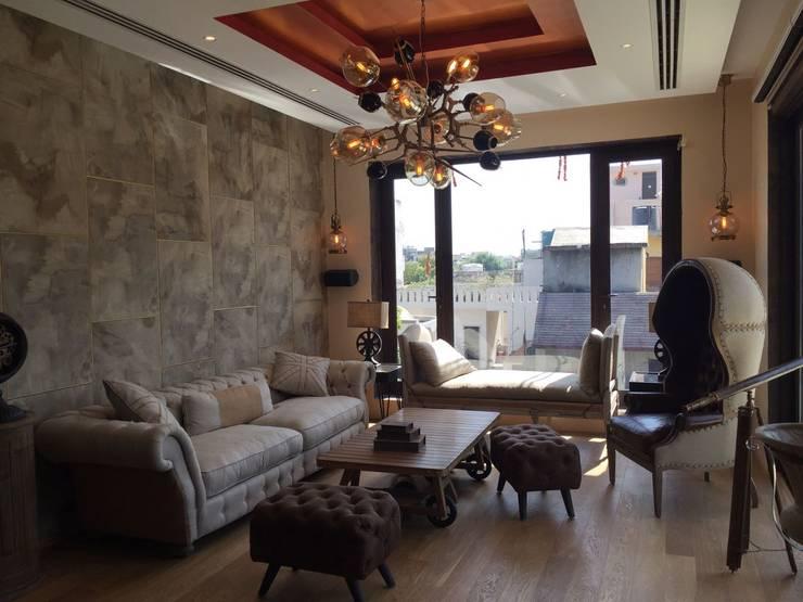 Burst Chandelier in Modern Living Room:  Living room by Jainsons Emporio