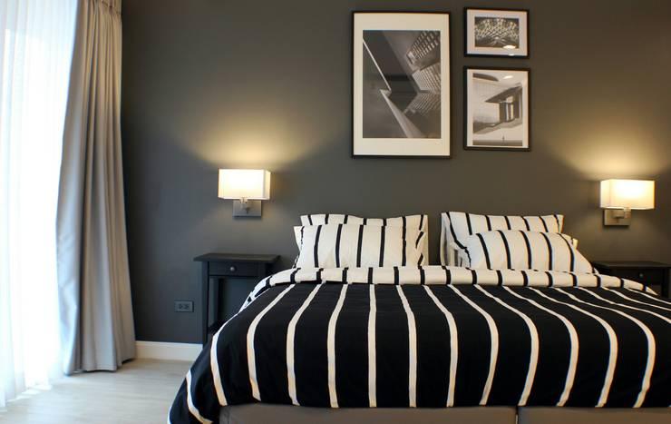 ปรับปรุงคอนโดเก่า ออกแบบตกแต่ง style modern Scandinavian:   by Glowingdesign
