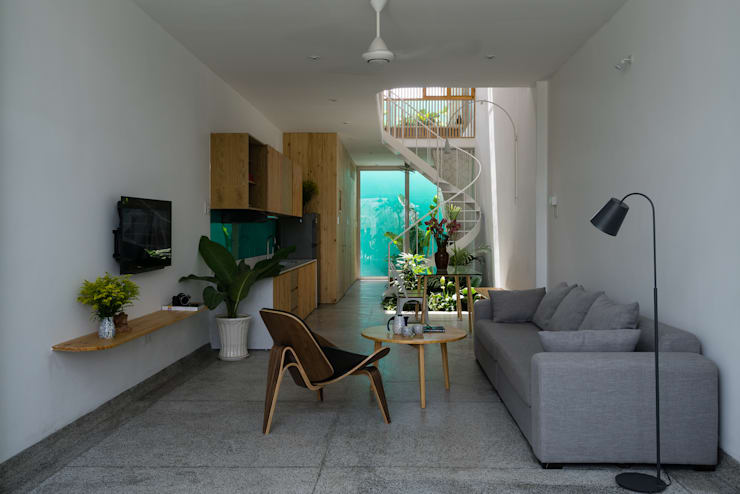 LESS house :  Phòng khách by workshop.ha