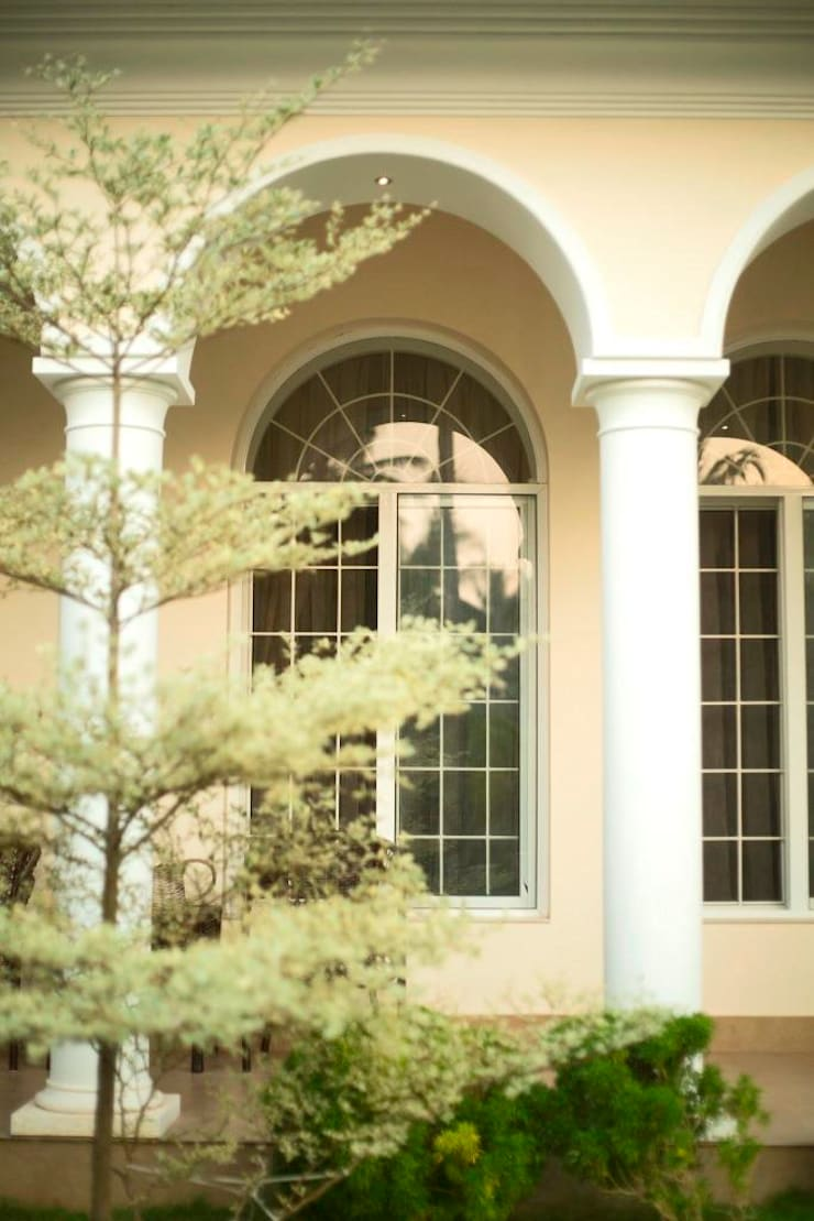 The House of Arches:  uPVC windows by S Squared Architects Pvt Ltd.