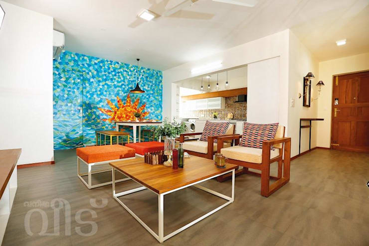 The Rising Sun Apartment: eclectic Living room by S Squared Architects Pvt Ltd.