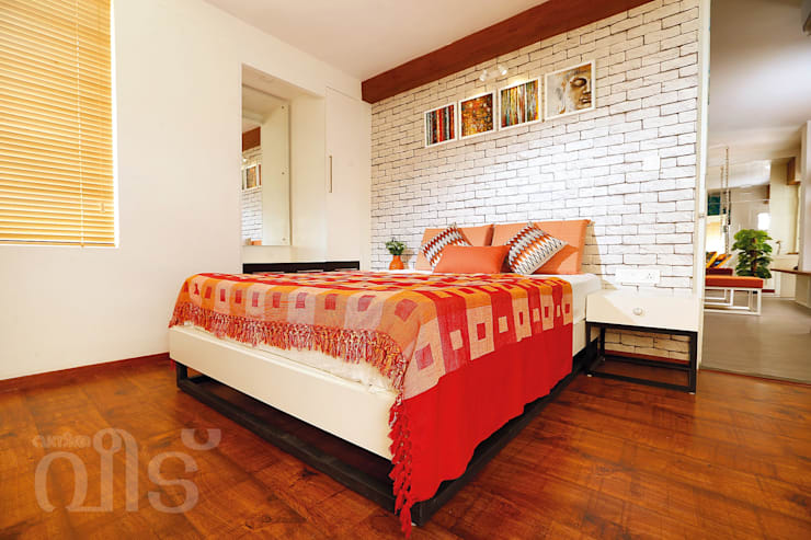 The Rising Sun Apartment: eclectic Bedroom by S Squared Architects Pvt Ltd.