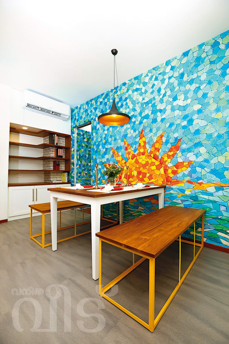 The Rising Sun Apartment:  Dining room by S Squared Architects Pvt Ltd.