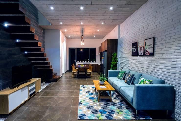 Không gian mở – gắn kết gia đình:  Phòng khách by Công ty TNHH Xây Dựng TM – DV Song Phát