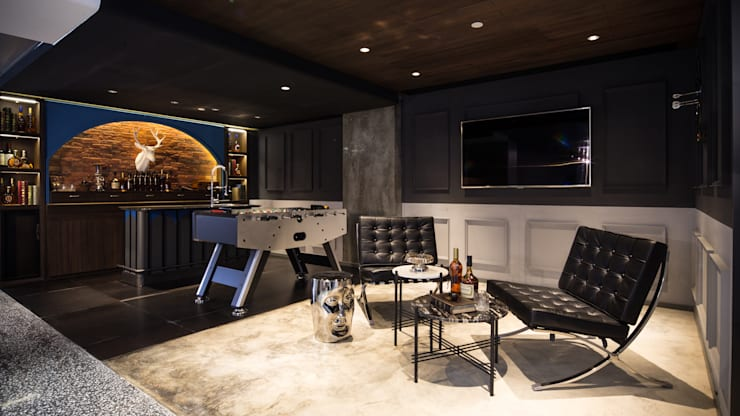 Private Club:  Living room by Artta Concept Studio