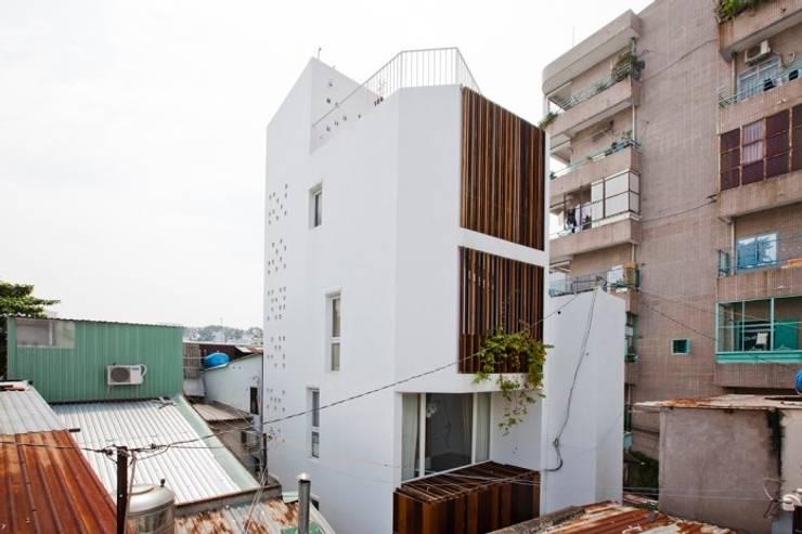Ngắm Diện Mạo Ngôi Nhà Phố 32m2 Tuyệt Đẹp Trong Hẻm Nhỏ Sài Gòn:  Nhà by Công ty TNHH Xây Dựng TM – DV Song Phát