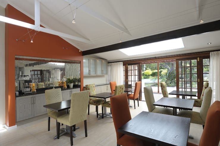 Renovations to Gardenview Guest House:  Dining room by The Matrix Urban Designers and Architects