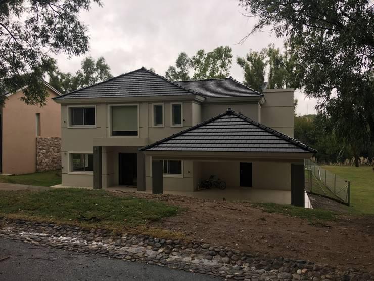 VIVIENDA BA: Casas unifamiliares de estilo  por BVS+GN ARQUITECTURA,Moderno
