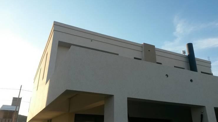 VIVIENDA PR: Casas unifamiliares de estilo  por BVS+GN ARQUITECTURA,