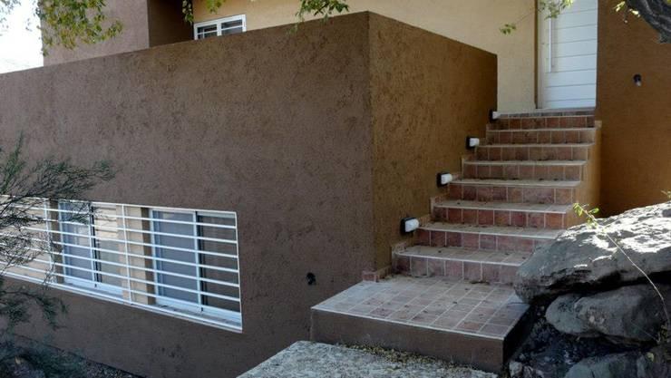 La casa de Tur: Casas de estilo  por muñoz bunteh arquitectos,