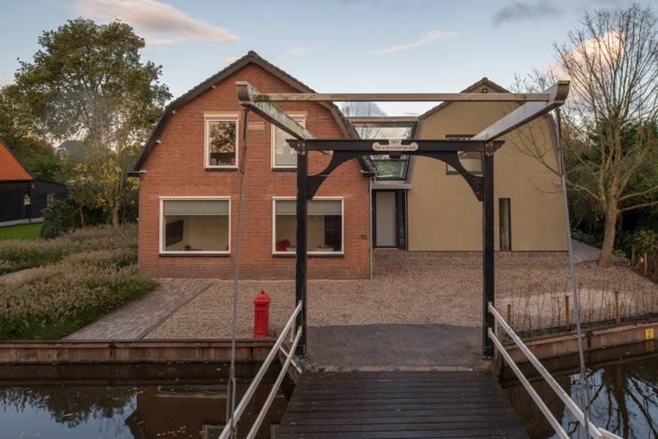 Situatie na: modern  door Architect2GO, Modern