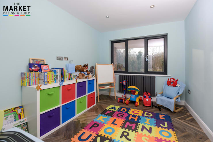 Nursery/kid's room by The Market Design & Build
