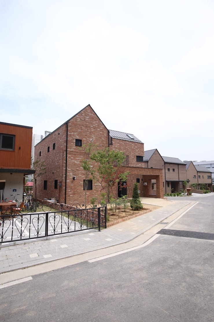 세종시 도담동 : 위드하임의  목조 주택,컨트리 벽돌