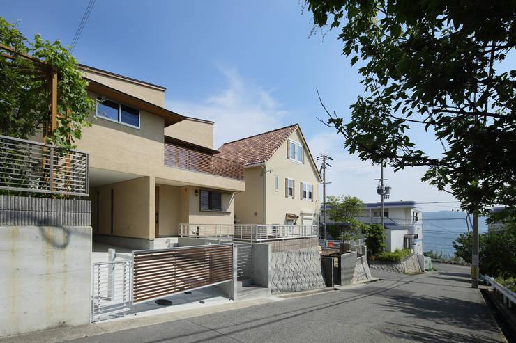 Single family home by アトリエdoor一級建築士事務所,