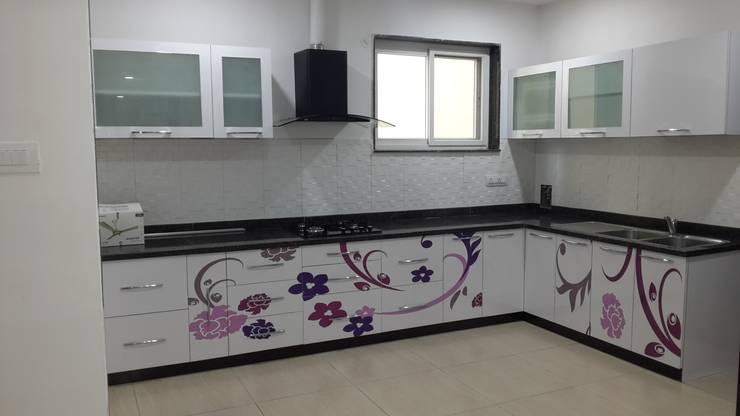 Residence@Hitech City:  Kitchen units by Studio Neev Interiors & Architects
