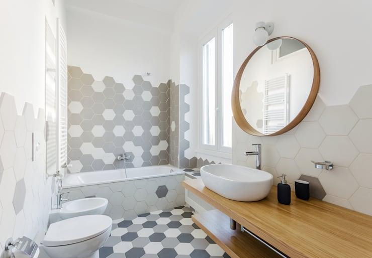 Baños de estilo  por Angelo Talia