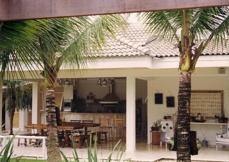 Casa NC: Terraços  por AM arquitetura e interiores