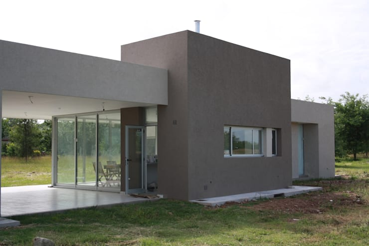Fachada de frente: Casas de estilo  por Arquitectura Bur Zurita,