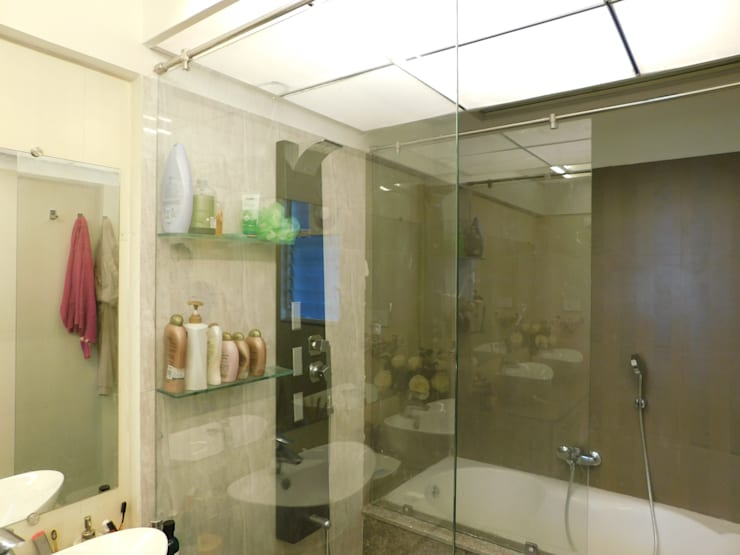 Interior: modern Bathroom by Inspire Interiors & Archcons India Pvt Ltd