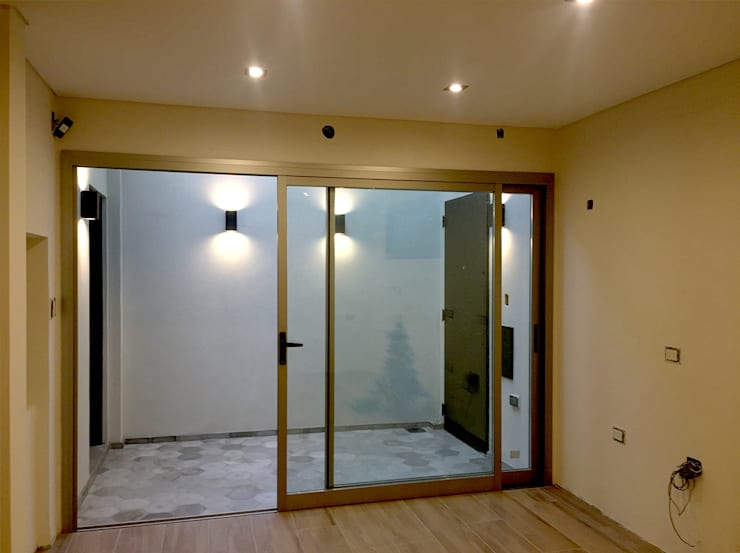 Salas / recibidores de estilo  por Casa Meva Estudio
