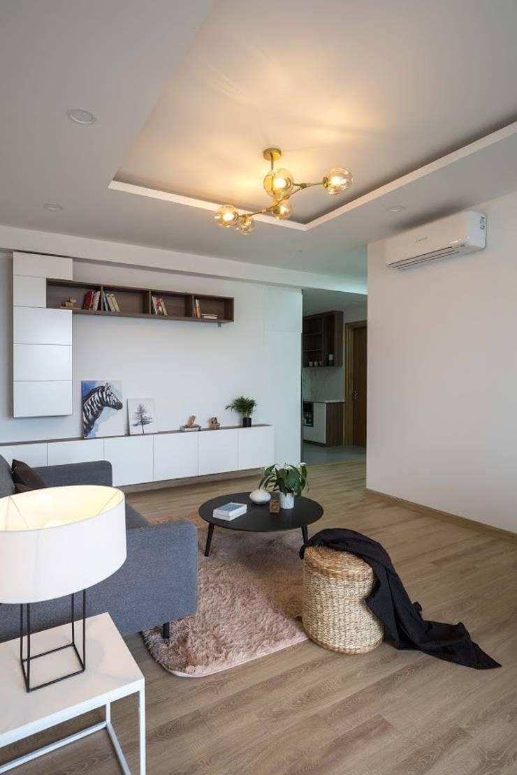 Phong cách của căn nhà này khá đơn giản, phóng khoáng.:  Phòng khách by Công ty TNHH Thiết Kế Xây Dựng Song Phát