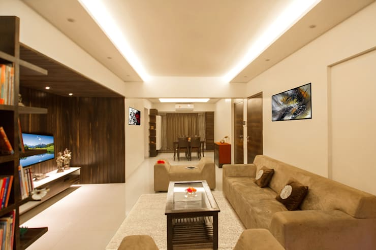 3 BHK at Borivali:  Living room by A Design Studio