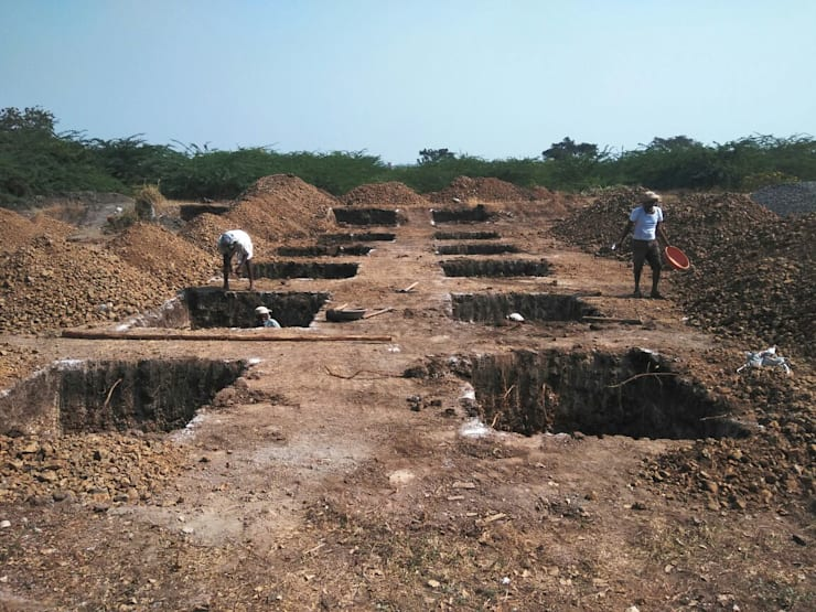 Footing Excavation:  Multi-Family house by Cfolios Design And Construction Solutions Pvt Ltd,Modern