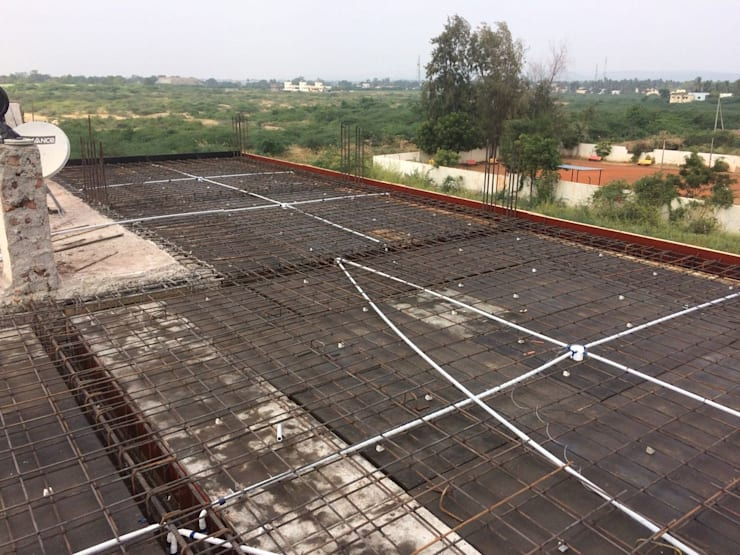 Reinforcement for first floor Slab:  Single family home by Cfolios Design And Construction Solutions Pvt Ltd,Modern Reinforced concrete