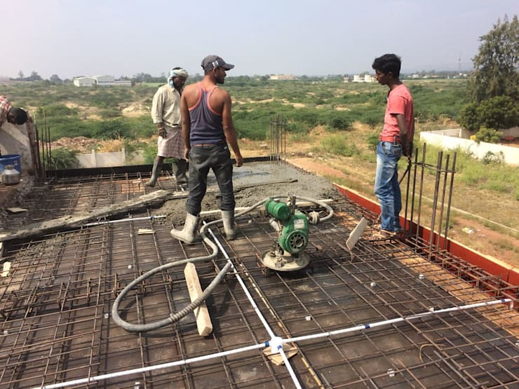 Casting of slab in progress:  Single family home by Cfolios Design And Construction Solutions Pvt Ltd,Modern
