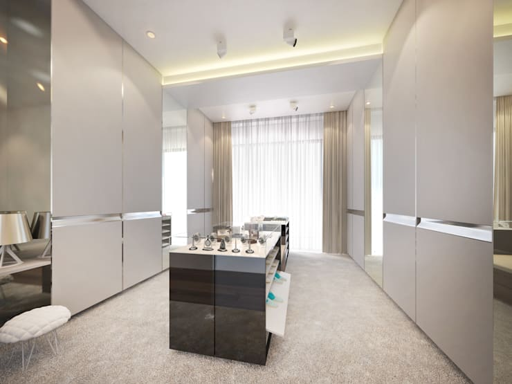 Walk-in closet:  Dressing room by Dessiner Interior Architectural