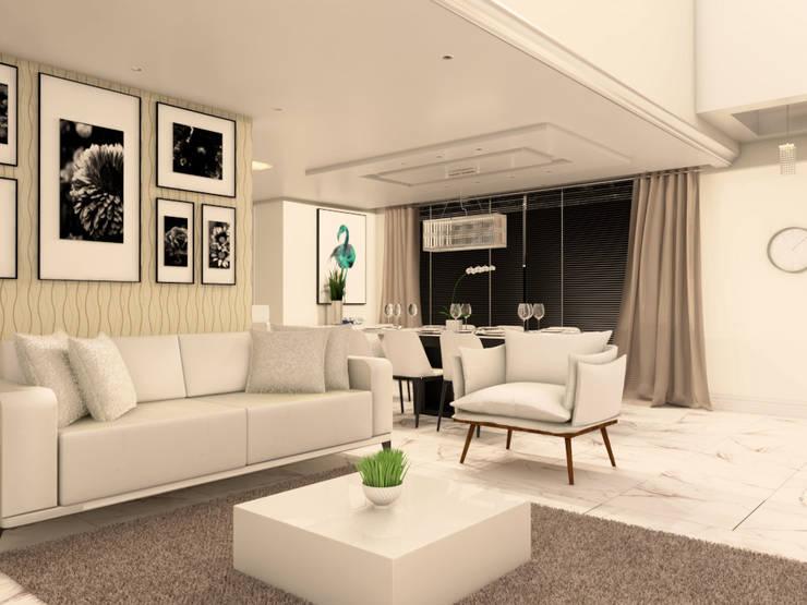 Sofá branco e ao fundo papel de parede: Salas de estar  por Janete Krueger Arquitetura e Design