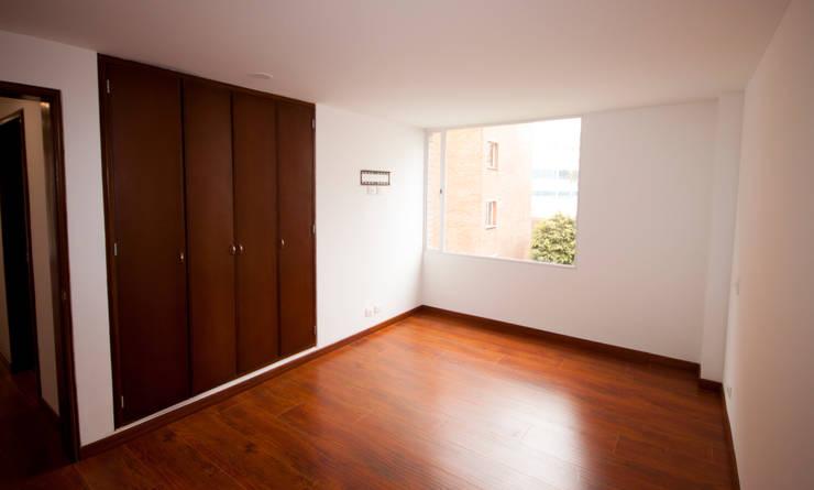 Apartamento Dimaté Gómez: Habitaciones de estilo  por AMR estudio